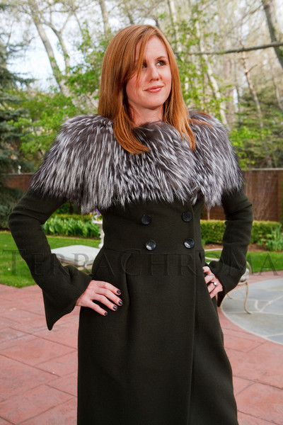 (Denver, Colorado, May 4, 2011)<br /> Taylor Pardun tries on a Forest green double-breasted coat with silver fox.  Trunk show by designer Wes Gordon at the home of Barbara Grogan in Denver, Colorado, on Wednesday, May 4, 2011.<br /> STEVE PETERSON