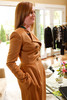 (Denver, Colorado, May 4, 2011)<br /> Taylor Pardun tries on a camel cashmere double-breasted coat.  Trunk show by designer Wes Gordon at the home of Barbara Grogan in Denver, Colorado, on Wednesday, May 4, 2011.<br /> STEVE PETERSON