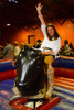 "(Littleton, Colorado, May 14, 2011)<br /> Maria Tuschall rides the mechanical bull.  ""The Barn Party,"" a kick-off to the Schomp BMW Denver Polo Classic, presented by Denver Active 20-30, at the stables of the Polo Reserve Development in Littleton, Colorado, on Saturday, May 14, 2011.<br /> STEVE PETERSON"