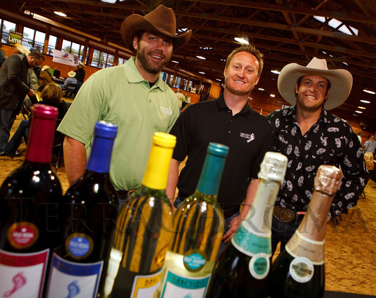 "(Littleton, Colorado, May 14, 2011)<br /> Steven Shoppman and Naren Tichy, representing Barefoot Wine, with Denver Active 20-30's Grant Langham.  ""The Barn Party,"" a kick-off to the Schomp BMW Denver Polo Classic, presented by Denver Active 20-30, at the stables of the Polo Reserve Development in Littleton, Colorado, on Saturday, May 14, 2011.<br /> STEVE PETERSON"