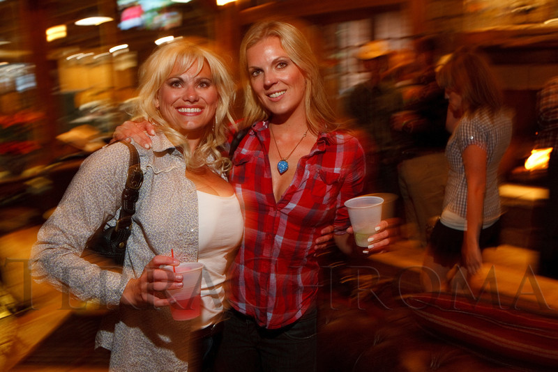 "(Littleton, Colorado, May 14, 2011)<br /> Angela Pokrywka (cq) and Genna Gregory (with Beverage Distributors / Grey Goose).  ""The Barn Party,"" a kick-off to the Schomp BMW Denver Polo Classic, presented by Denver Active 20-30, at the stables of the Polo Reserve Development in Littleton, Colorado, on Saturday, May 14, 2011.<br /> STEVE PETERSON"