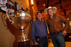 "(Littleton, Colorado, May 14, 2011)<br /> Denver Active 20-30's Dennis Buelow (charity review chair) and Chris Haeck (president) near a display in the VIP Lounge including the DPC championship trophy.  ""The Barn Party,"" a kick-off to the Schomp BMW Denver Polo Classic, presented by Denver Active 20-30, at the stables of the Polo Reserve Development in Littleton, Colorado, on Saturday, May 14, 2011.<br /> STEVE PETERSON"