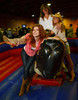 "(Littleton, Colorado, May 14, 2011)<br /> After riding the mechanical bull, Jane O'Brien, Maria Tuschall, and Brandy Horan have their friends take a picture.  ""The Barn Party,"" a kick-off to the Schomp BMW Denver Polo Classic, presented by Denver Active 20-30, at the stables of the Polo Reserve Development in Littleton, Colorado, on Saturday, May 14, 2011.<br /> STEVE PETERSON"