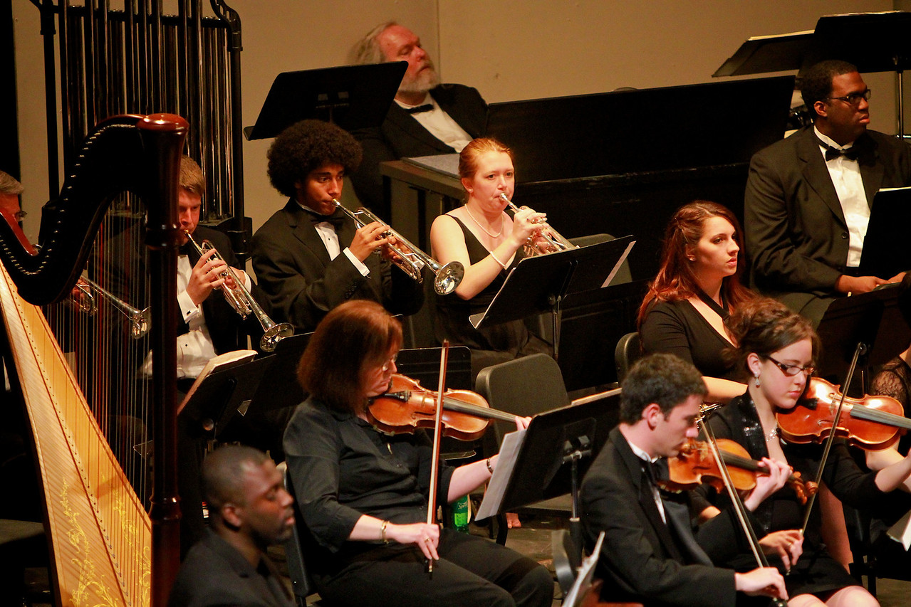 """The Gardner-Webb Orchestra joins the Josh Cogan Band to debut GWU Student Josh Cogan's musical thesis composition, """"Double Crossed"""" in Spring of 2011."""