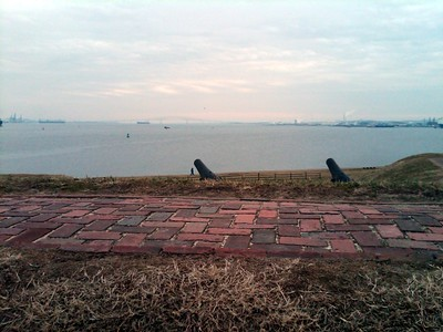 View from a rampart of Fort McHenry, looking at Baltimore Harbor and up the Patapsco River.  In the far background is the modern-day Francis Scott Key Bridge.   The ship from which Francis Scott Key saw the Star-Spangled Banner Flag was just beyond where the bridge is today. (2/21/11)