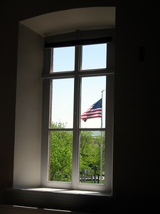 The U.S. flag at the National Law Enforcement Officers Memorial, visible from the Pension Commissioner's Suite at the National Building Museum (4/24/11)