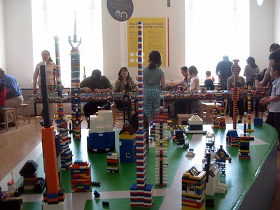 Children build LEGO models in the LEGO® Architecture: Towering Ambition exhibit at the National Building Museum (4/24/11)