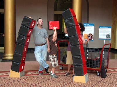 A family interacts with an exhibit on arches and keystones at the National Building Museum (4/24/11)