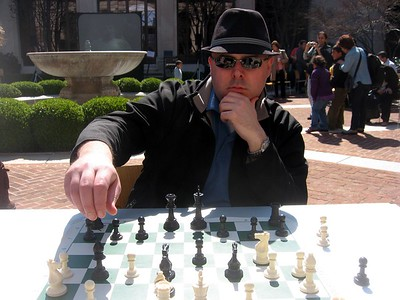 Craig and DJ play chess as part of a celebration of Nowrūz, in the courtyard of the Smithsonian's Freer Gallery of Art (3/13/11)