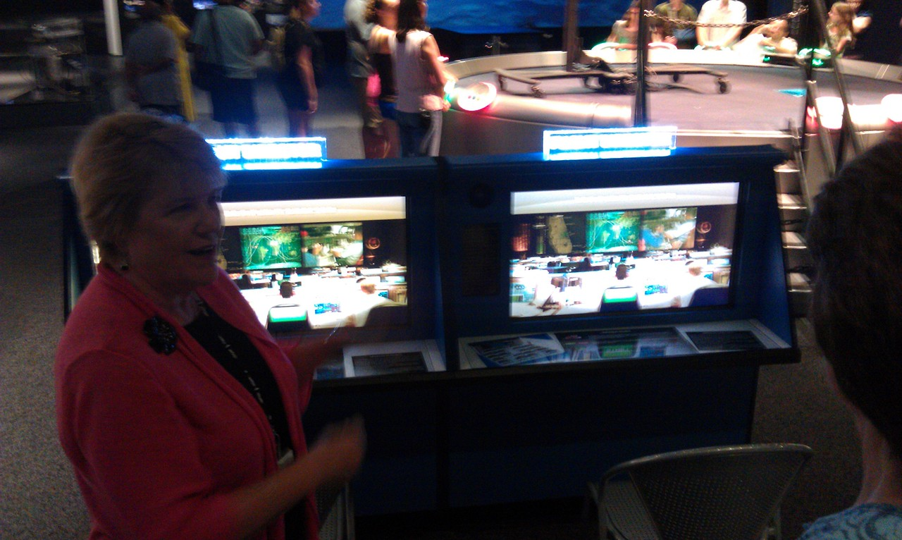 "Valerie Neal, curator of the Post-Apollo Human Spaceflight Collection at the Smithsonian's National Air and Space Museum, provides a tour of the Moving Beyond Earth exhibit during a ""tweeunion"" of space tweeps (8/8/11)"
