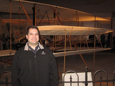 In front of the 1903 Wright Flyer, the first powered, heavier-than-air machine to achieve controlled, sustained flight with a pilot aboard; at the Smithsonian's National Air and Space Museum (2/26/11)