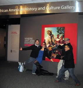 At the entrance to the Kinsey Collection, in the gallery of the National Museum of African American History and Culture.  In the background is a reproduction of The Cultivators, by Samuel L. Dunson, Jr. (2000).  The gallery is currently located at the Smithsonian's National Museum of American History, until the NMAAHC's building is constructed next door (2/20/11)