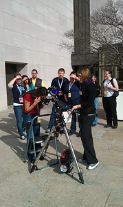 Looking at the Sun through a telescope at the Public Observatory of the National Air and Space Museum.  (Safety Note)