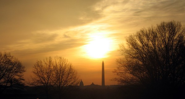 The Sun rises over the U.S. Capitol and the Washington Monument, as seen from Rosslyn