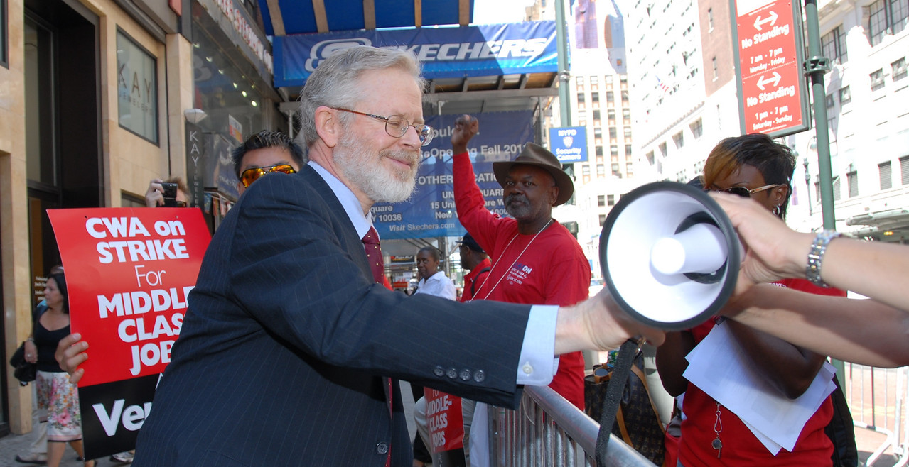 "New York Assemblyman Dick Gottfried visits a picket line in front of a Verizon Wireless store in midtown. ""I come from a Union family and I'm here to show my support""."