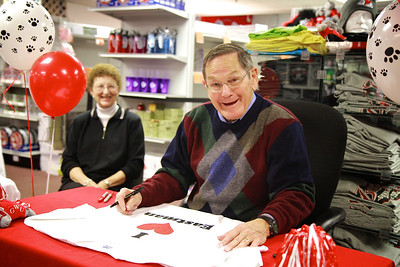 Dr. Anthony Eastman signs custom designed t-shirts in the bookstore; Nov 18, 2011.