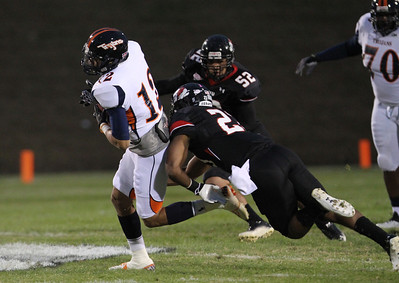 Alonzo Winfield, number 23, attempts to tackle VSU's number 12, Corey Young.