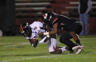 Number 42, Devin Johnson, tackles VSU's number 5, Sean Smith.