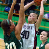 Tribune-Star/Jim Avelis<br /> Young gun: Northview freshman Mikyla Rowan shoots over the defense of West Vigo center Erin Barton.