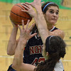 Tribune-Star/Jim Avelis<br /> Coming through: Terre Haute North's Nicole Anderson drives inside for two points despite the defense of Greencastle forward Taylor Pruitt.