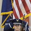 Present the colors: U.S. Air Force Tech Sgt. Kelli Wietlisbach of the 181st Intelligence Wing leads the base honor guard as the team presents the colors during the Veterans Day ceremony Thursday at Honey Creek Middle School.