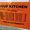Mission sign: Detail of soup kitchen hours of operation.