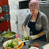 Salad prep: Stacia O'Connell prepares a salad Thursday afternoon in her downtown restaurant.