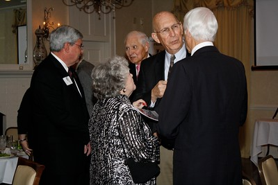 C. Lorance Henderson speaks with Mr. and Mrs. Ron Hawkins.