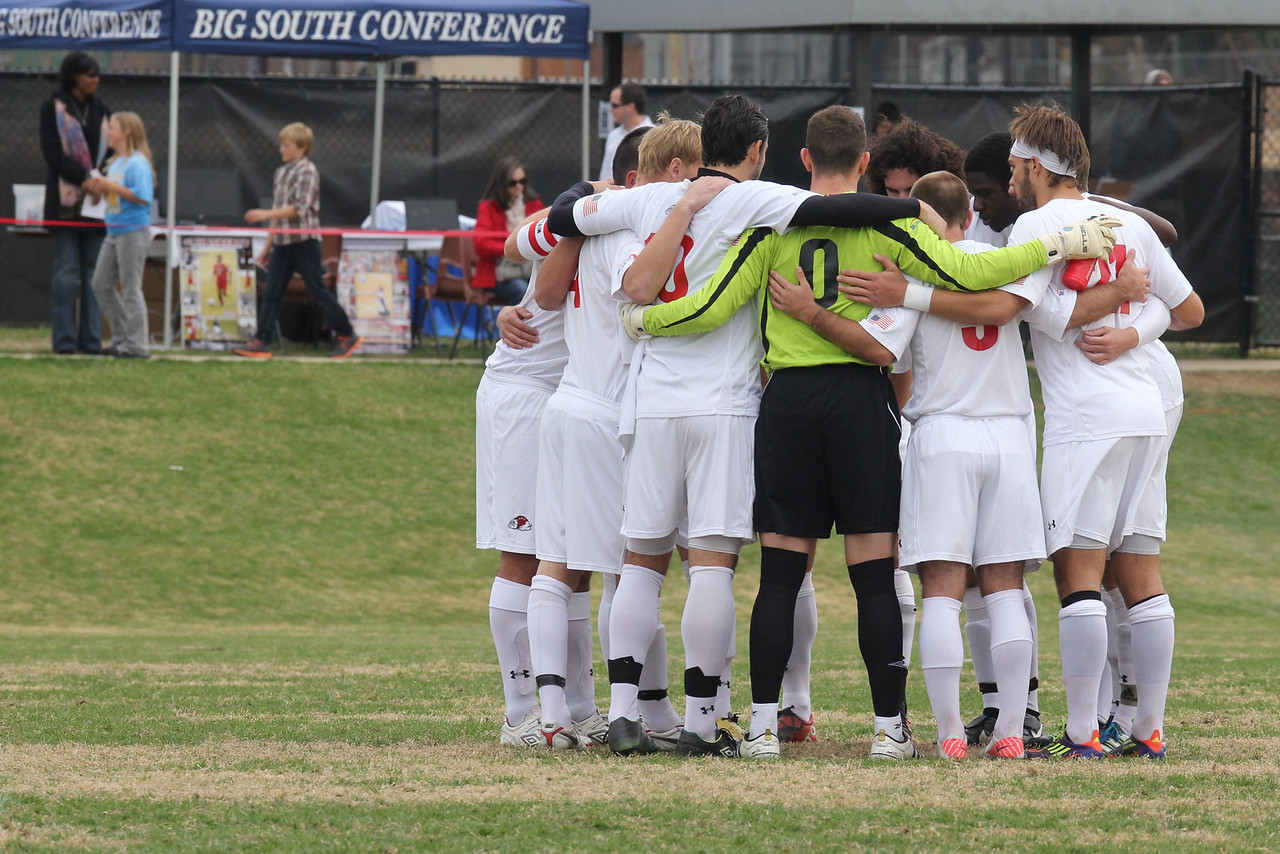 The team huddles before the game begins.