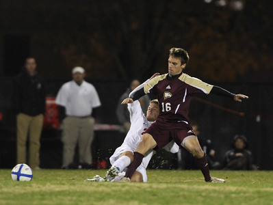 Number 20, John Sargent, battles Winthrop for the ball.
