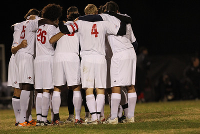 GWU's soccer team huddles before the game.