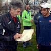 Tribune-Star/Joseph C. Garza<br /> Words of running wisdom: 1972 Olympic gold medal winner Frank Shorter autographs a book for Indiana State University runner Al Escalera Sunday before a community run at Memorial Stadium.