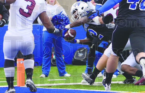 Second half score fest: Indiana State's Shakir Bell dives into the endzone to score for the Sycamores in the second half of action against Southern Illinois Saturday at Memorial Stadium.