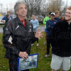 Tribune-Star/Joseph C. Garza<br /> Knowing Pre: Olympian Frank Shorter talks about time spent with his late friend, Steve Prefontaine, before he autographs a photo of himself and Prefontaine together Sunday at Memorial Stadium. Looking on is Alex Jennermann, who presented the photo to Shorter.