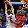 Tribune-Star/Joseph C. Garza<br /> 5 comes alive: Indiana State's Justin Gant maneuvers past a block by Ball State's Jarrod Jones to score during the Sycamores' win Friday at Hulman Center.