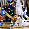 Get down: Indiana State's #13, Jake Odum goes to the floor for a loose ball against Eastern Illinois guard L.C. Doss Friday night at Hulman Center.