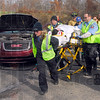 Wreck victim: Emergency personnel move the injured driver of the above vehicle to a waiting ambulance along Lambert Road near Rukes Road on the Vigo/Parke County line Friday afternoon.