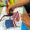 Patriotic colors: Ten-year-old Destiny Rader colors a card to send to a vet during her visit to the Children's Museum Friday afternoon.