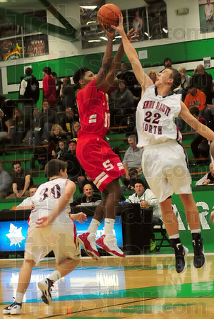 Blocked: North's #22, Steven Davis blocks the shot of South's #30, Jermaine Smith during jamboree action Friday.