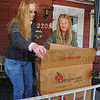 Tribune-Star/Jim Avelis<br /> Helping hand: Terre Town residents Gail Phillips and Patricia Weaver load donated food into boxes Thursday afternoon. The food will be distributed through Terre Town Elementary School for Thanksgiving.
