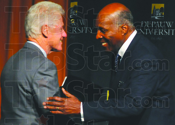 """Old friends: Bill Clinton is greeted on stage by longtime friend and Depauw University alum Vernon Jordan. Clinton was in Greencastle to give his speech """"Embracing out Common Humanity."""