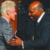 "Old friends: Bill Clinton is greeted on stage by longtime friend and Depauw University alum Vernon Jordan. Clinton was in Greencastle to give his speech ""Embracing out Common Humanity."