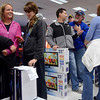 Tribune-Star/Joseph C. Garza<br /> Holiday hospitality: Even though the lines to check out may have been a little long, Black Friday shoppers were patient and even jovial with one another. Here, at H.H. Gregg, cousins Kelsey Hughes of Ellettsville and Mackenzie Brush of Brazil share a laugh as they wait in line right after midnight Friday at the electronics and appliances retailer.