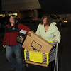Tribune-Star/Joseph C. Garza<br /> The best deal: Michele Abrams of Sullivan pushes her recently purchased desktop computer to her car right after midnight Friday after finding it as a Black Friday deal at Best Buy. With Abrams is her daughter, Ashton Abrams of Bloomington.