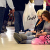 Tribune-Star/Joseph C. Garza<br /> On a shopping schedule: Alexis Joy and her grandmother, Peggy Joy, of Clinton, pass the time browsing through a catalog as they wait for the opening of a store at the Honey Creek Mall shortly after midnight Friday.
