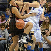 Tribune-Star/Jim Avelis<br /> Fits right in: Bellarmine forward Darion Hutchinson recoils from contact with Indiana State newcomer Sadie Oyer in first half action in their exhibition game Friday night.