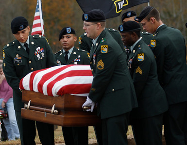 The Honor Guard carries Staff Sgt. Chris Newman's casket at Cleveland Memorial Park in Shelby, NC.