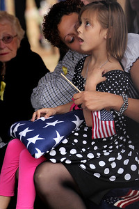 Anyca Miller, the five year-old daughter of Staff Sgt. Chris Newman, holds the flag she was presented during the military funeral for Newman in Shelby, NC on November 9, 2011. Newman and three other US servicemen were killed in a suicide car bombing October 29 in Kabul, Afghanistan.