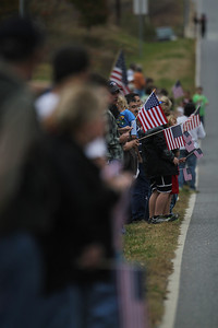 The crowd waves their flags in honor and memory of Staff SGT Chris Newman.