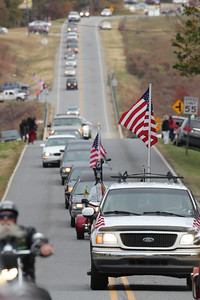 American flags are waved everywhere in honor and memory of Staff SGT Chris Newman